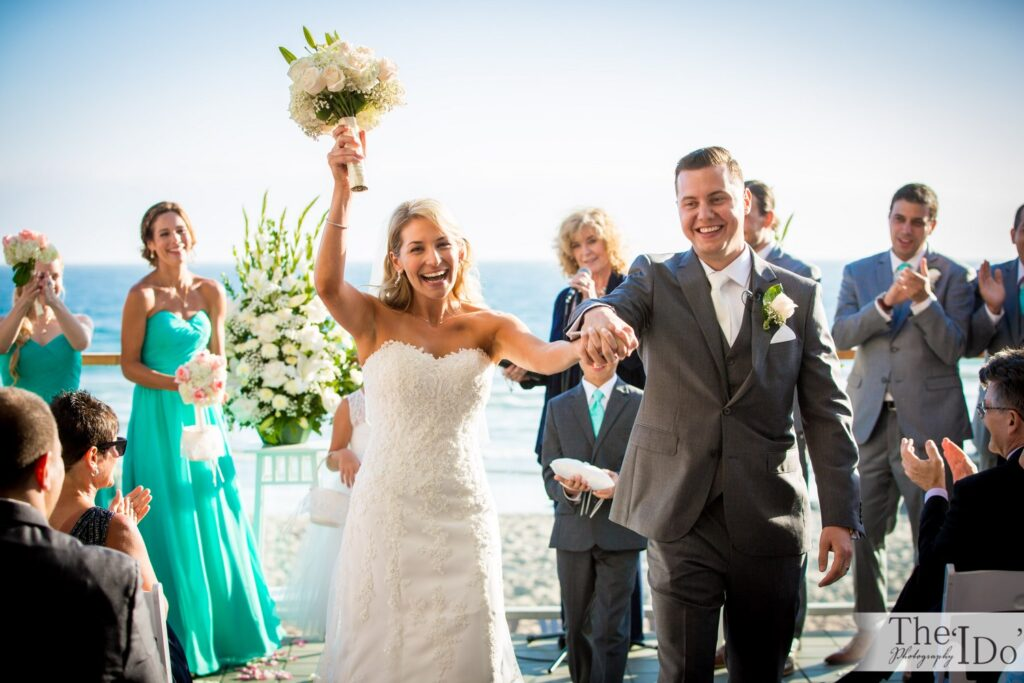 """A Beautiful past Client of ours walking back down the aisle after saying """"I DO"""""""