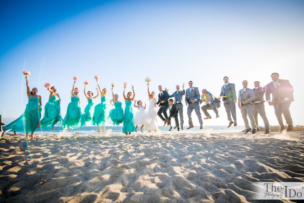 We love beach shots for a bridal party group jumping shot!